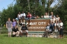 The group poses at the entrance of Bay City State Recreation Area.