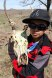 Damian poses with an elk skull we found while participating in a service project with Friends of the Wichitas.