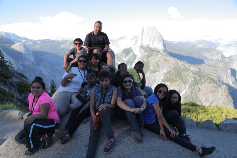 The group poses in front of Half Dome at Glacier Point.